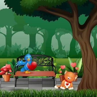 Kreskówka niebieski ptak i kot w parku
