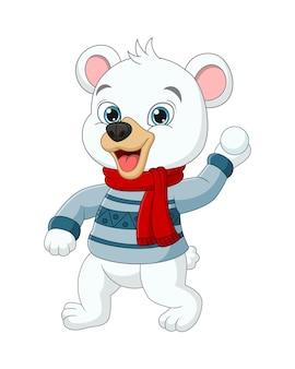 Kreskówka niedźwiedź polarny w zimowe ubrania rzucające śnieżką
