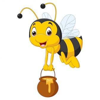 Kreskówka pszczoła trzyma wiadro miodu