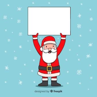 Kreskówka santa claus trzyma puste miejsce znaka