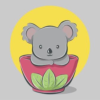 Kreskówka śliczna koala w misce