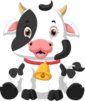 Kreskówka słodkie dziecko krowa pozuje siedząc