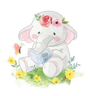 Kreskówka słoń czyta książkę w ogrodzie
