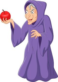Kreskówka stara wiedźma trzyma czerwone jabłko