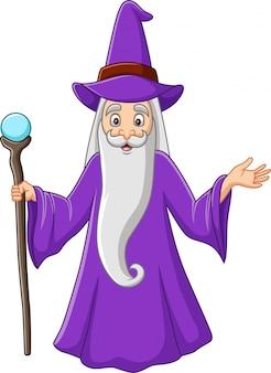 Kreskówka stary czarownik trzyma magicznego kij