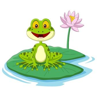 Kreskówka zielona żaba siedzi na liściu