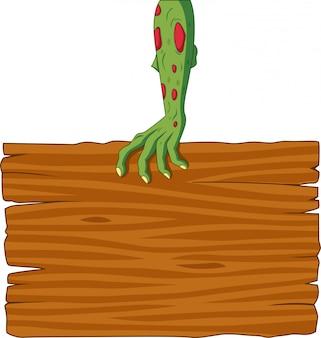 Kreskówka zombie ręka trzyma pusty znak