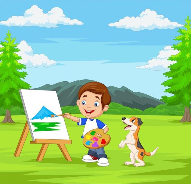 Kreskówki chłopiec maluje z jego zwierzęciem domowym w parku