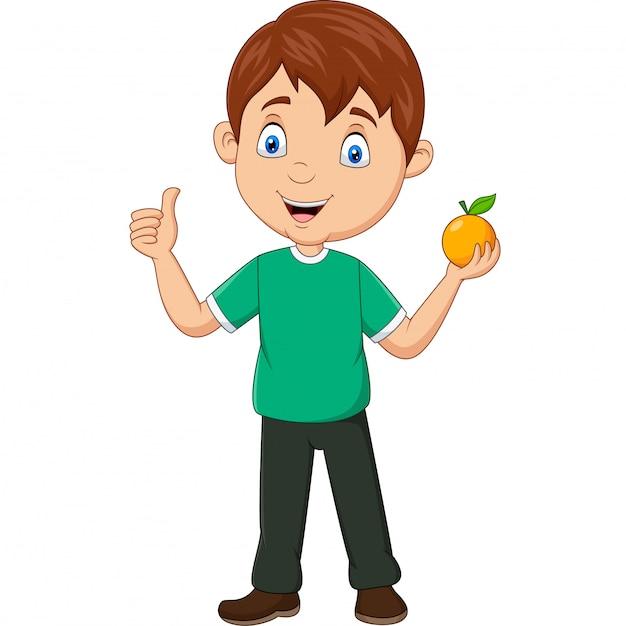 Kreskówki chłopiec trzyma pomarańczową owoc i daje aprobatom