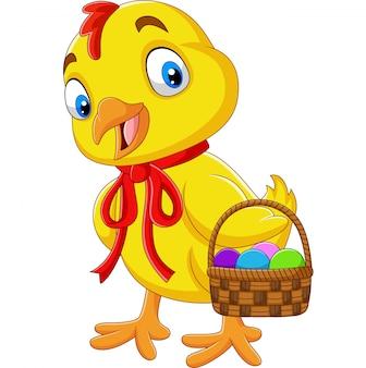 Kreskówki dziecka kurczątko trzyma kosz wielkanocny jajko