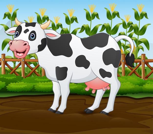 Kreskówki krowa w klatce z zieloną rośliną