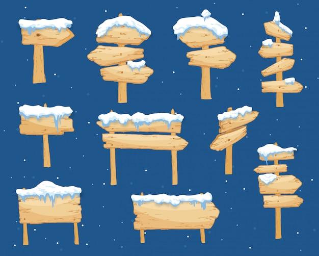 Kreskówki zimy drewniany znak z śnieżną nakrętki ilustracją. tablica śnieżna. drewniana strzałka kierunkowa, pokryta śniegiem. zestaw ilustracji