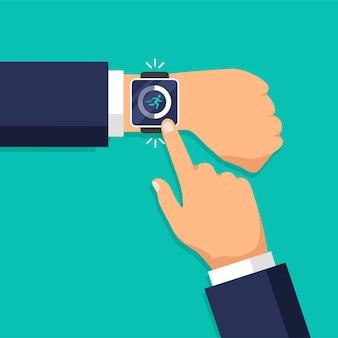 Kroki fitness i aplikacja do śledzenia biegu na inteligentnym zegarku. krokomierz. aktywność dnia. mężczyzna klika na wyświetlacz