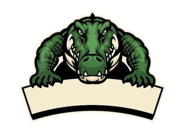 Krokodyl maskotka trzyma pusty baner na tekst