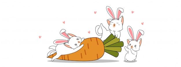 Królicze koty i marchewka w dzień wiosny