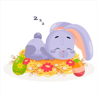 Królik śpi w gnieździe.