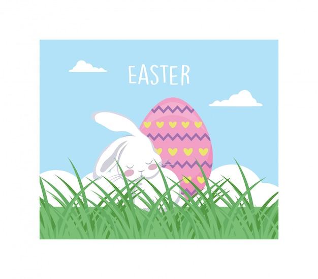 Królik z etykiety wielkanocne i jajko, kartkę z życzeniami