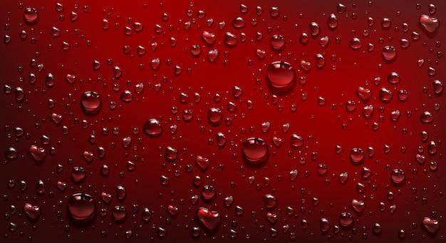 Kropelki wody na czerwonym tle