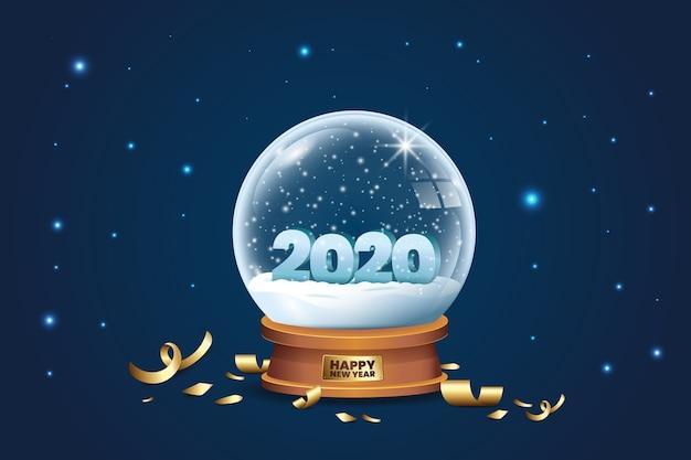 Kryształowa kula ziemska ze śniegiem i konfetti na 2020 rok