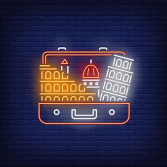 Krzywa wieża w pizie i koloseum w neonowej walizce otwartej