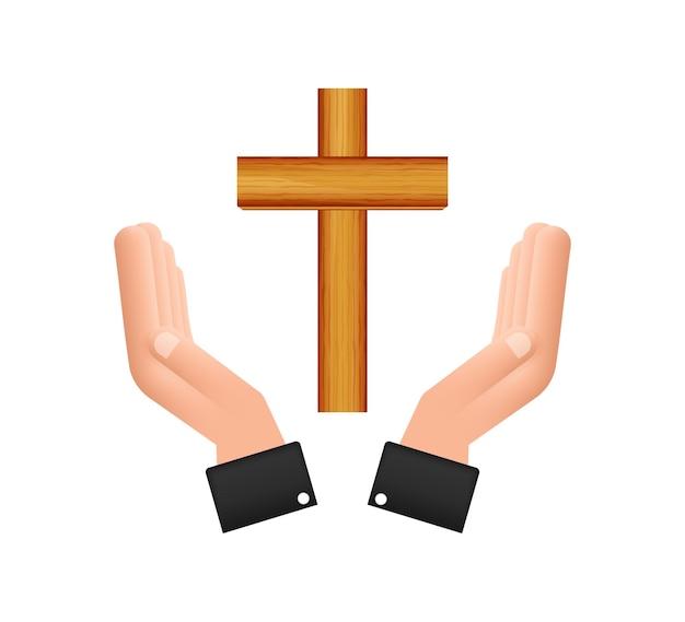 Krzyż ikona drewna w ręce projekt na białym tle. ikona religii.