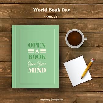 Książka z kubkiem kawy i papieru