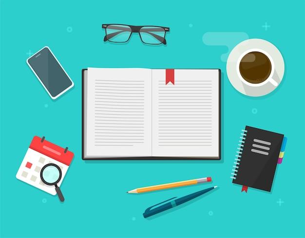 Książka lub dziennik notatnika otwarty na stole do nauki