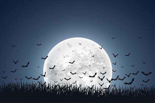 Księżyc z latającymi nietoperzami na tle nieba