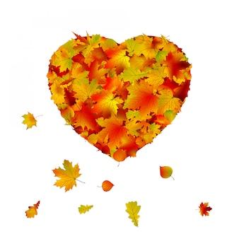 Kształt serca wykonany z liści jesienią.