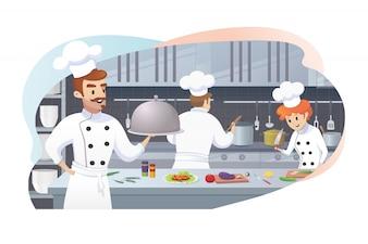 Kucharz trzyma tacę w ręku pracowników kuchni