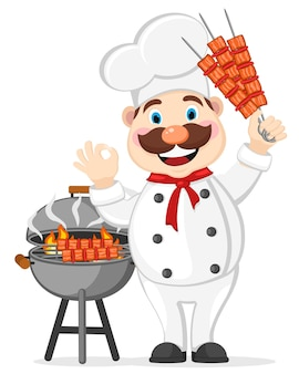 Kucharz uśmiecha się i gotuje grilla