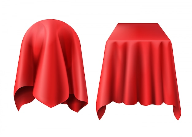 Kula i pudełko pokryte czerwoną szmatką