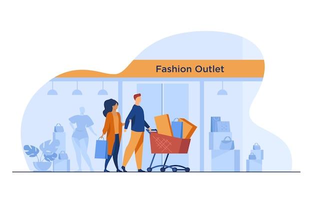 Kupujący przechodzą obok okna outletu z modą. klienci na kołach wózek z ilustracji wektorowych płaskie torby i paczki. konsumpcjonizm, koncepcja zakupu
