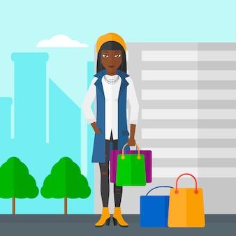 Kupujący z torbami na zakupy.