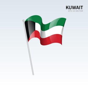 Kuwejt macha flagą na szarym tle