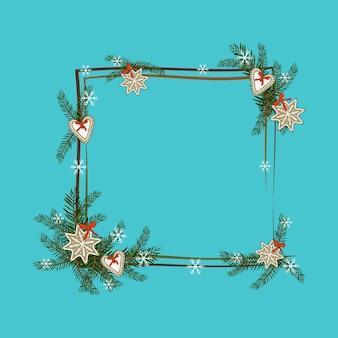 Kwadratowa ramka świąteczna z gałęzi jodłowych z piernikiem, gwiazdą i płatkiem śniegu. świąteczna dekoracja na nowy rok i ferie zimowe