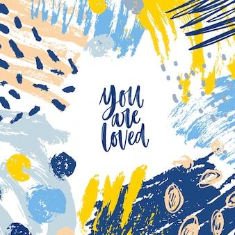 Kwadratowe tło z inspirującą wiadomością you are loved i ramką składającą się z chaotycznych plam, pociągnięć pędzla, bazgrołów i śladów farby