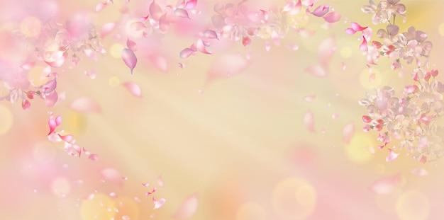 Kwiat wiśni i latające płatki na wiosnę