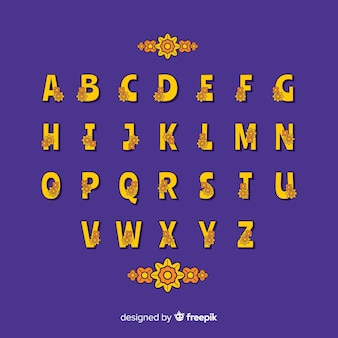 Kwiatowy alfabet w stylu lat 60-tych na niebieskim tle