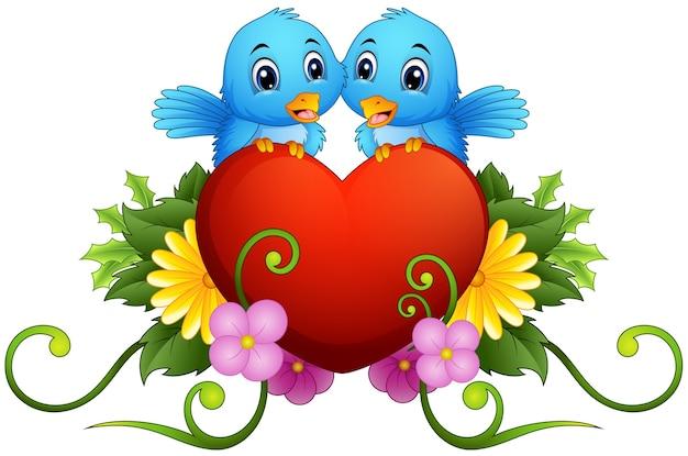 Kwiatowy ornament z serca i niebieskie ptaki