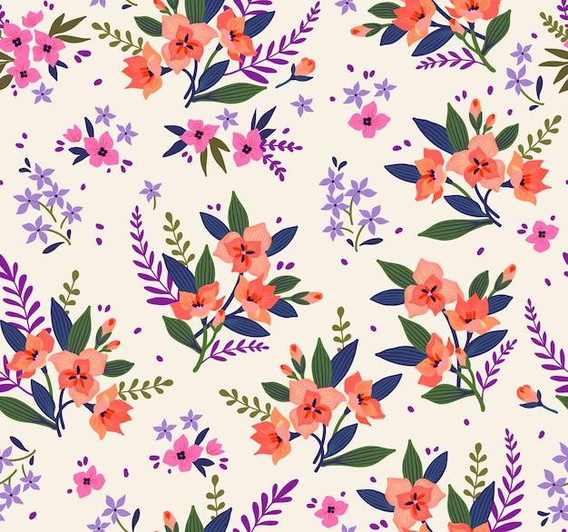 Kwiatowy wzór. ładne kwiaty, białe tło. nadruk z małymi pomarańczowymi kwiatkami. drobny nadruk