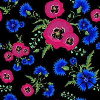 Kwiatowy wzór z czerwonymi makami i niebieskimi chabrami.