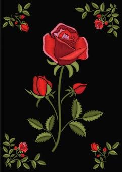 Kwiatowy zszywany ornament ze ściegiem różanym. kwiat haftu na ciemnym tle tkaniny klapy. robótki ozdobne.