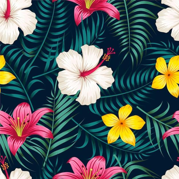 Kwiecisty bezszwowy wzór z liścia tropikalnym tłem