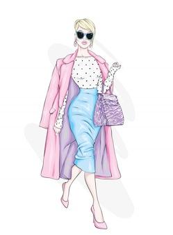 Ładna dziewczyna w modnych ciuchach. ilustracja.