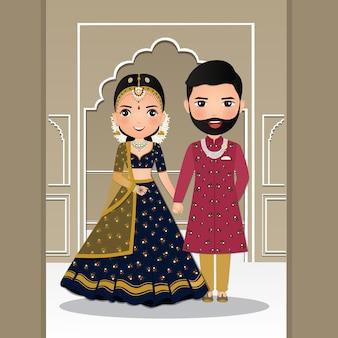 Ładna para panna młoda i pan młody w tradycyjnym indyjskim stroju kreskówki