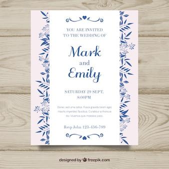 Ładne płaskie zaproszenie na ślub z niebieskimi ornamentami