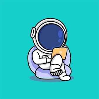 Ładny astronauta pracujący na kreskówce laptopa