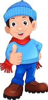 Ładny chłopak dając kciuki do góry