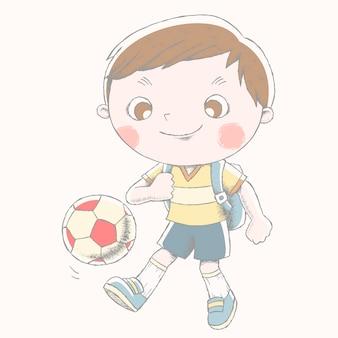 Ładny chłopak gra w piłkę nożną z jego tornister